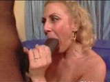 Older blond takes a young black cock