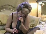 Mature woman with black monster dildo
